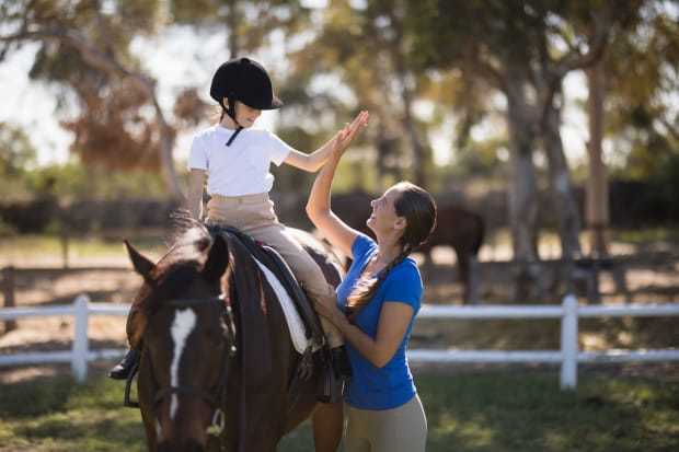 lesson-riding-girl-woman-horse-happy-istock-837983142-2400.jpg