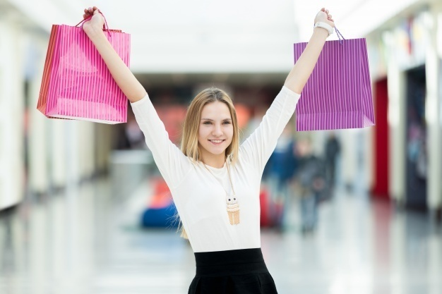 smiling-woman-with-purchase-bags_1218-78.jpg